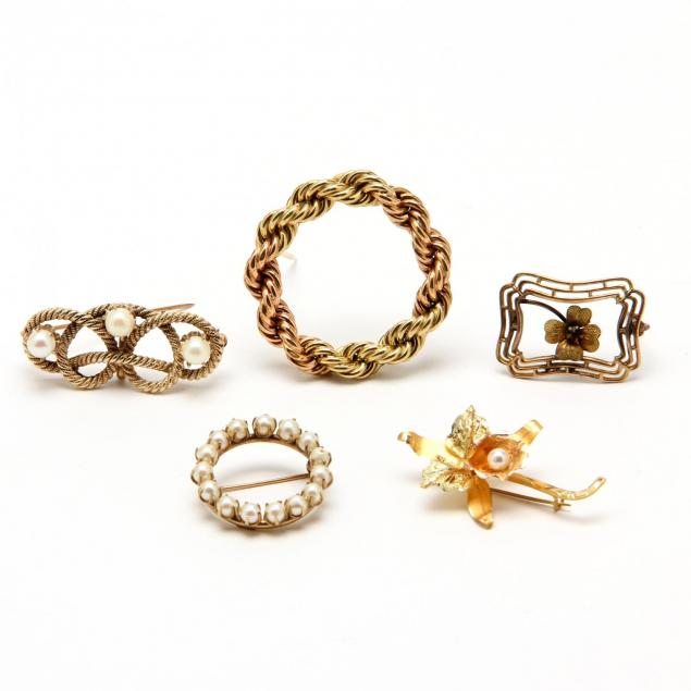 four-gold-brooches-and-one-gold-filled-brooch
