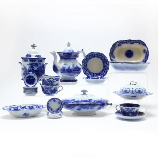 approximately-40-pieces-of-antique-flow-blue-table-accessories