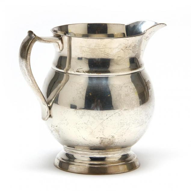 a-sterling-silver-milk-pitcher-by-tuttle-silversmiths