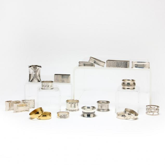 a-collection-of-twenty-sterling-silver-silverplate-napkin-rings