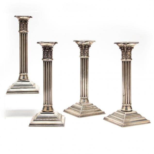 a-set-of-four-sterling-silver-corinthian-column-candlesticks