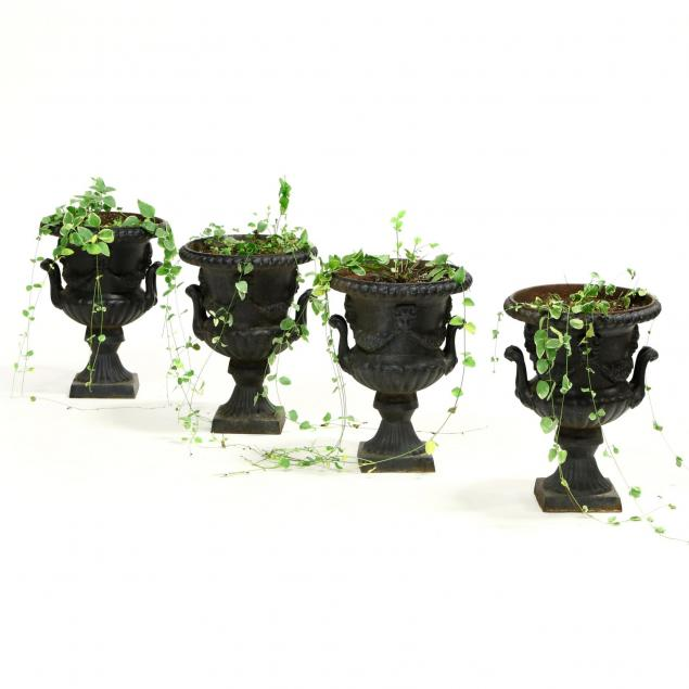 four-diminutive-cast-iron-urns