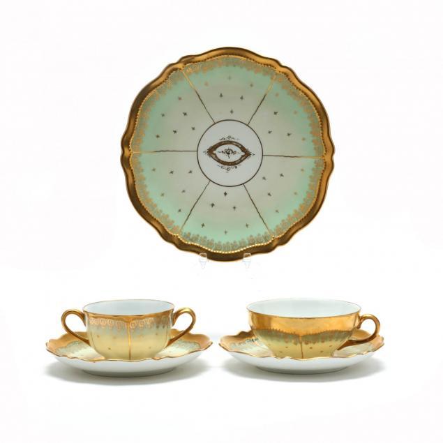 an-antique-egyptian-revival-porcelain-luncheon-set