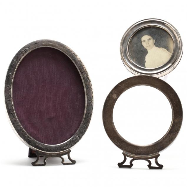 three-silver-picture-frames