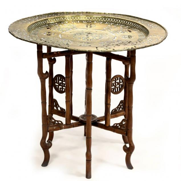 a-wooden-carved-foldable-chinese-table-with-brass-table-top