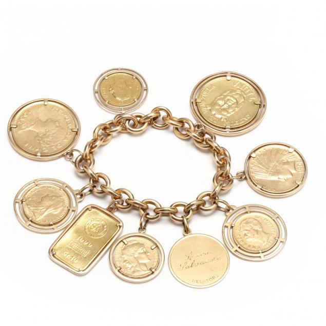 an-18kt-gold-bracelet-with-a-gold-charm-a-gold-bar-and-seven-gold-coins