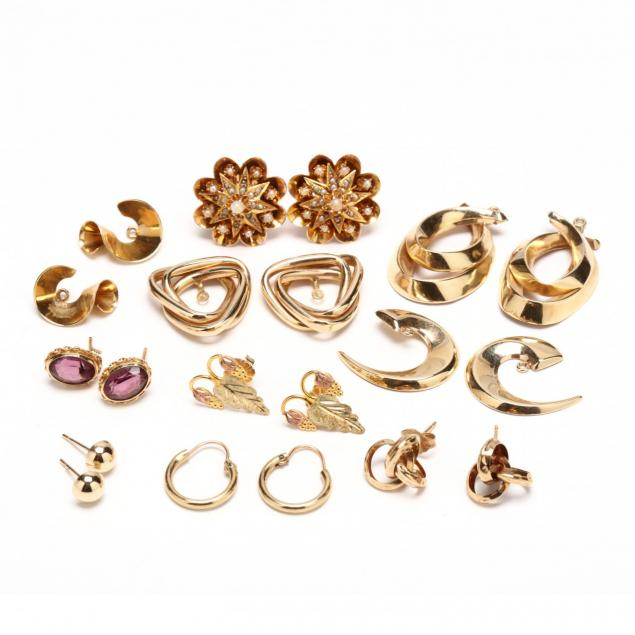 a-collection-of-gold-earrings-and-jackets