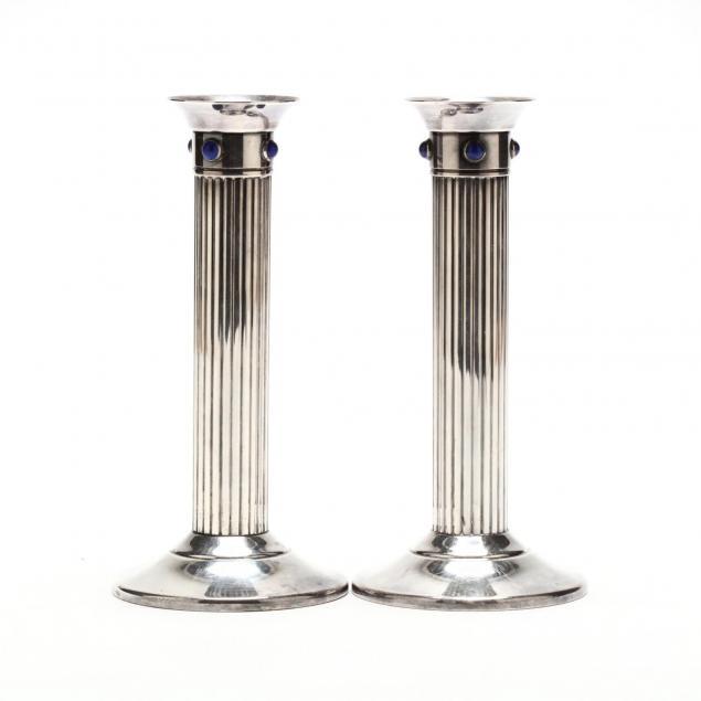 a-pair-of-cartier-silverplate-candlesticks