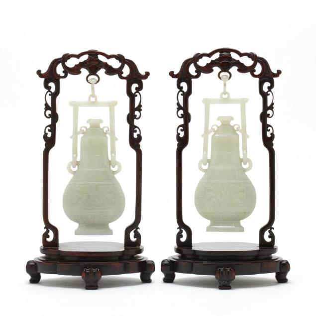 a-pair-of-pale-celadon-jade-hanging-vases-with-covers