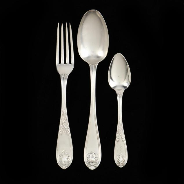 group-of-ornate-coin-silver-flatware