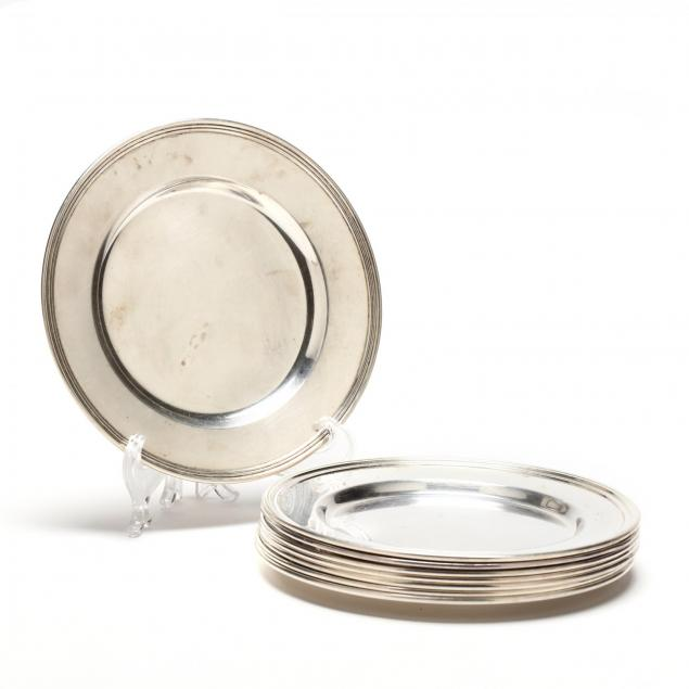an-assembled-set-of-eight-sterling-silver-bread-plates