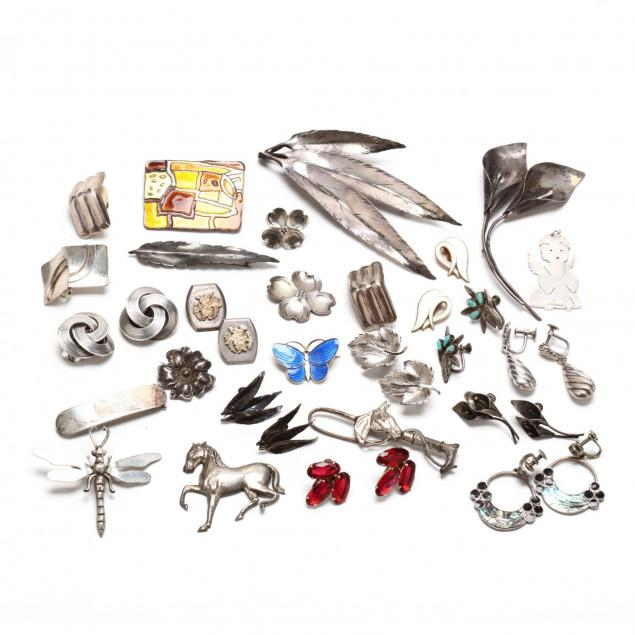 large-group-of-silver-earrings-and-brooches