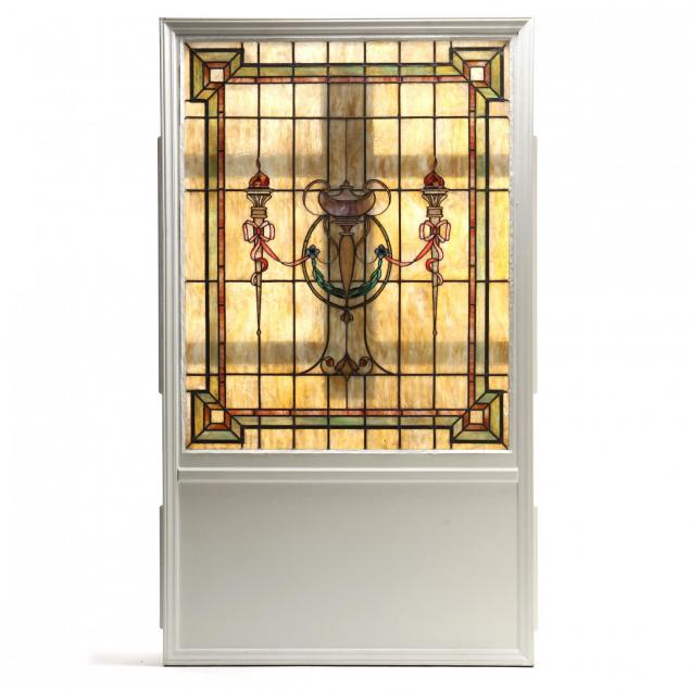 antique-classically-decorated-stained-glass-window-in-lighted-frame