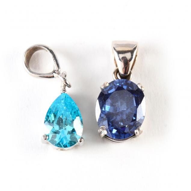 two-white-gold-gem-set-pendants