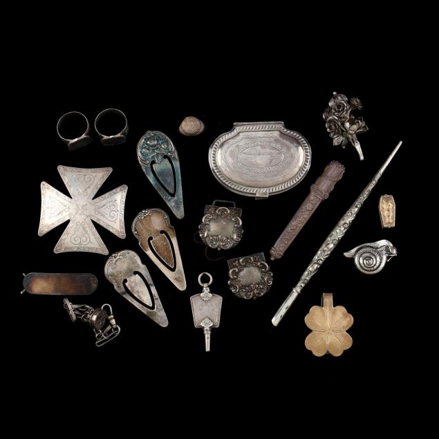 a-group-of-silver-jewelry-and-novelties