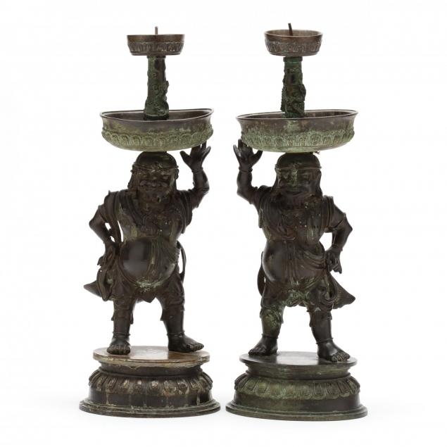 a-rare-pair-of-chinese-bronze-foreigner-pricket-candlesticks