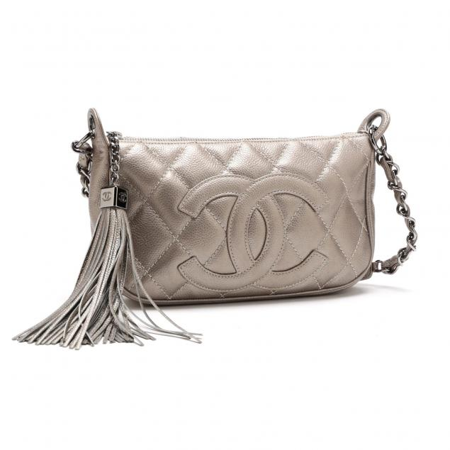 a-quilted-silver-leather-pouchette-chanel
