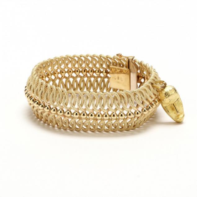 14kt-gold-bracelet-with-18kt-charm