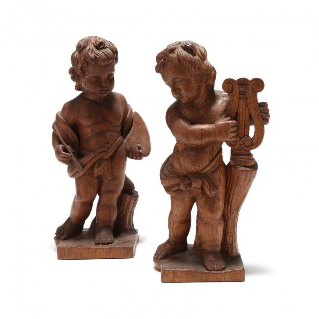 pair-of-carved-oak-putti
