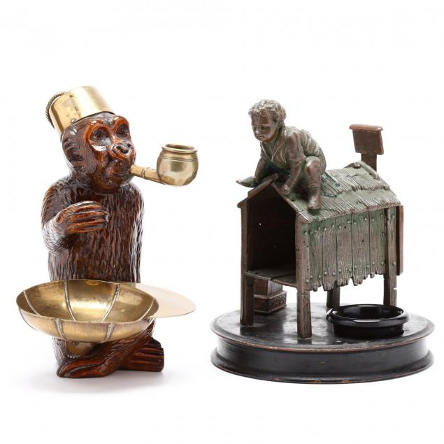 two-antique-figural-smoking-accessories