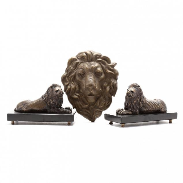 pair-of-lion-form-bookends-and-wall-mask