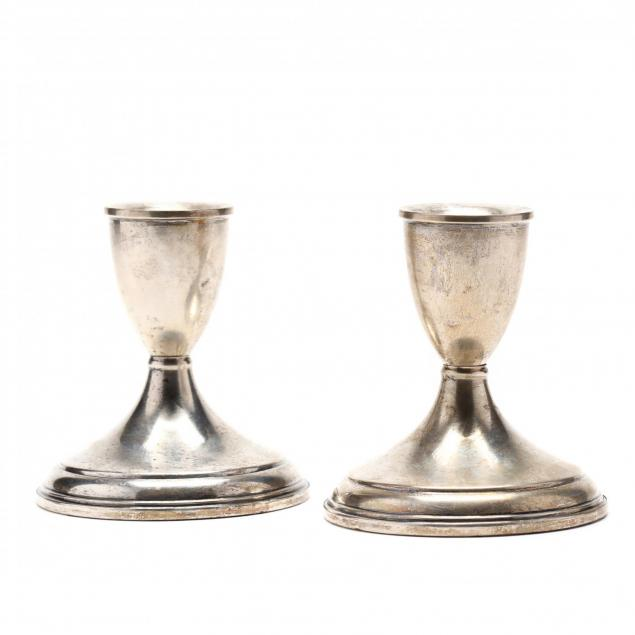 a-pair-of-sterling-silver-candlesticks