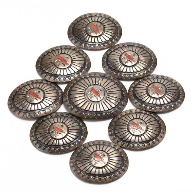 nine-southwestern-inlaid-silver-conchos
