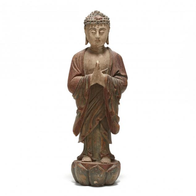 a-standing-carved-wooden-statue-of-a-buddha
