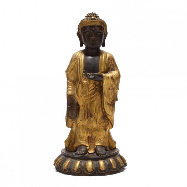 a-standing-bronze-statue-of-a-buddha