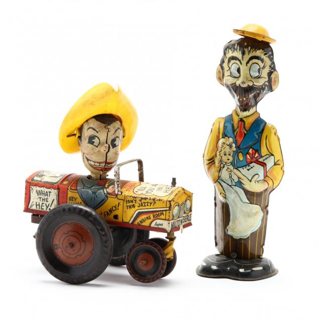 two-vintage-tin-wind-up-toys