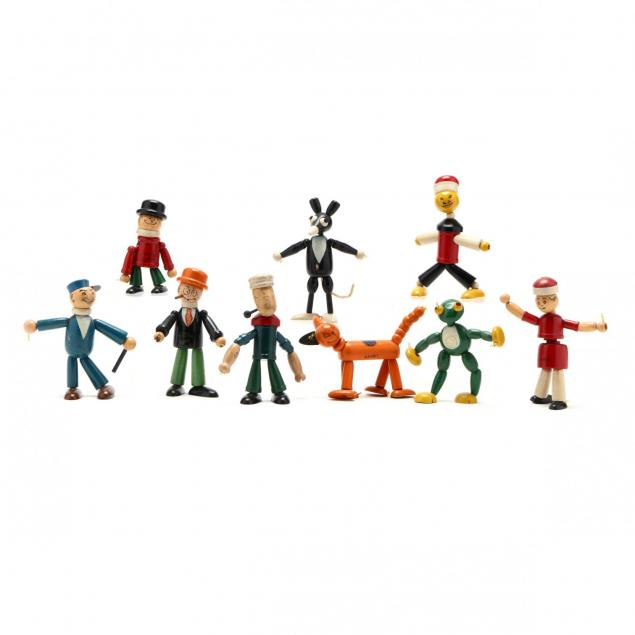 a-group-of-articulated-wooden-toys