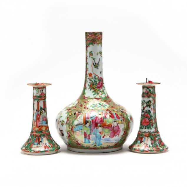 a-chinese-famille-rose-pair-of-candle-sticks-and-bottle-vase