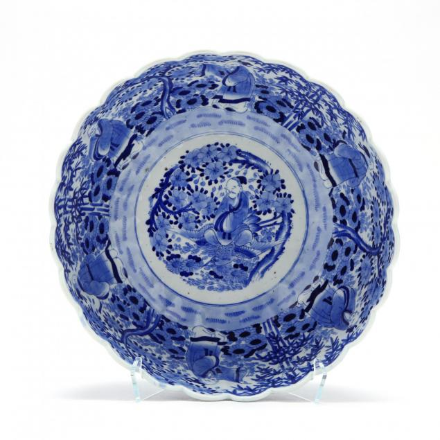 a-blue-and-white-punch-bowl-with-scalloped-rim