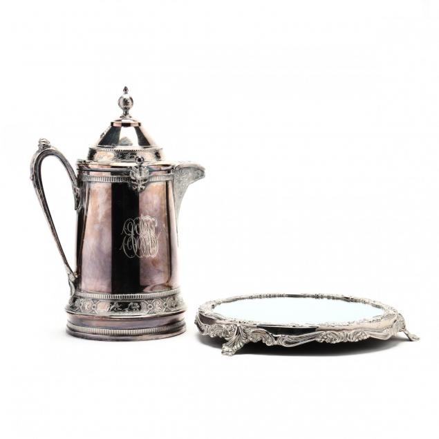 a-silverplate-ice-water-pitcher-and-mirrored-plateau