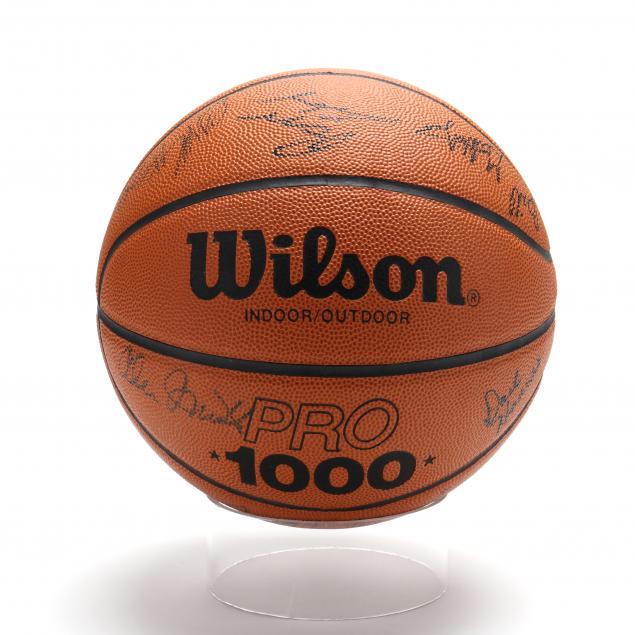 unc-team-signed-basketball-including-shammond-williams-and-ed-geth