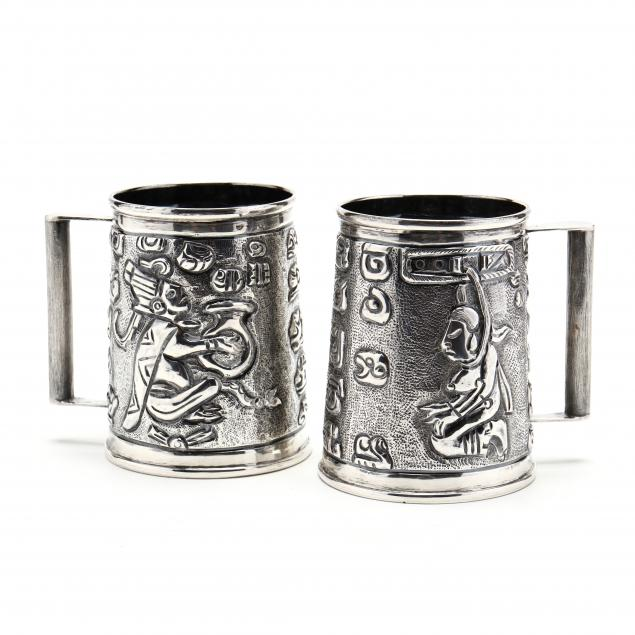 a-pair-of-sterling-silver-tankards-with-aztec-motifs