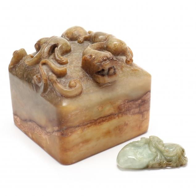 a-chinese-hard-stone-seal-and-a-jade-amulet
