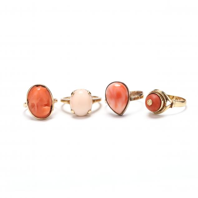 four-gold-and-coral-rings
