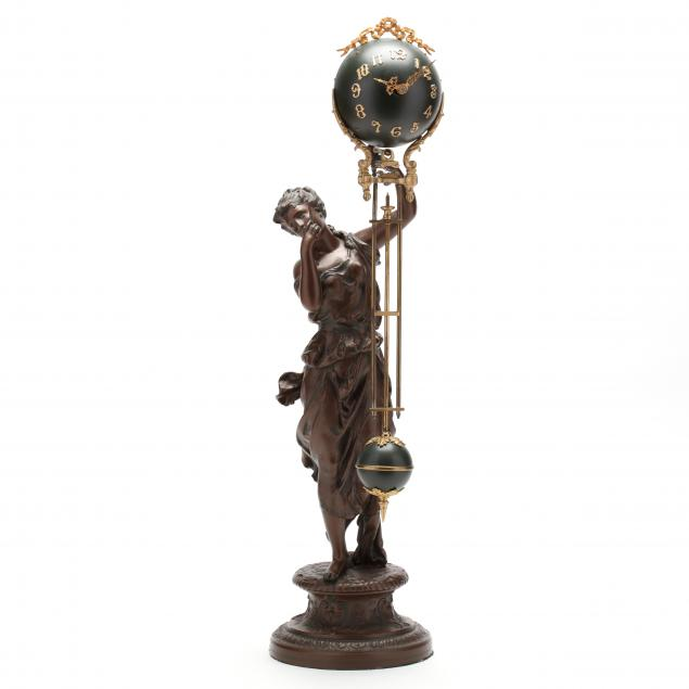 figural-swinging-clock