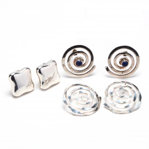 three-pairs-of-silver-earrings