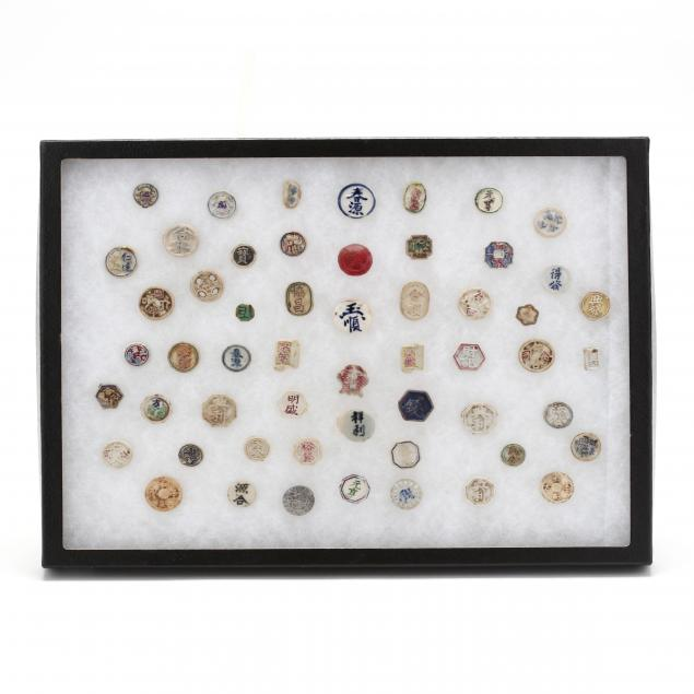 collection-of-55-colorful-siamese-porcelain-i-pee-i-gambling-tokens