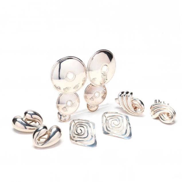 four-pairs-silver-earrings