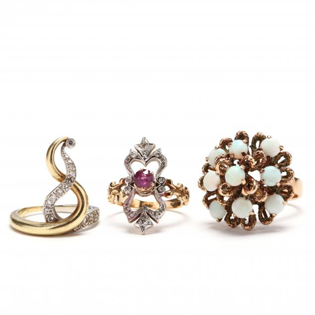 three-vintage-gold-and-gem-set-rings