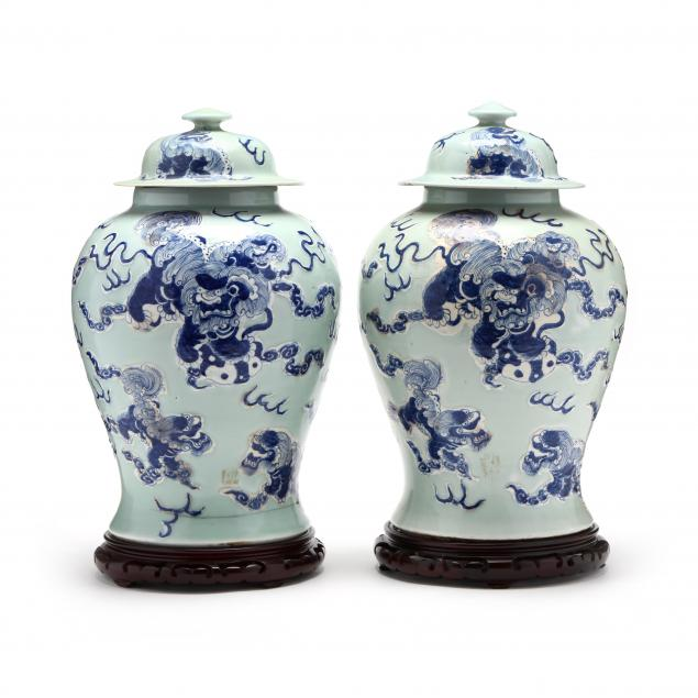 a-pair-of-large-chinese-celadon-covered-jars-with-foo-lions