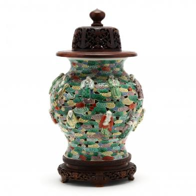a-chinese-cloud-and-immortal-jar-with-wooden-cover-and-stand