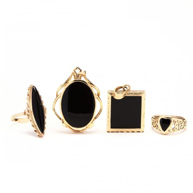 four-gold-and-black-onyx-jewelry-items