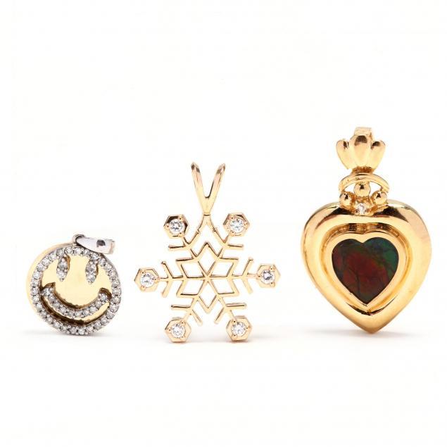 three-gold-and-gemstone-pendants