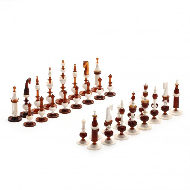 oleg-raikis-russia-20th-century-amber-and-ivory-selenus-style-chess-set