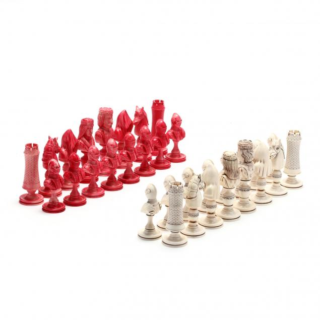 oleg-raikis-russia-20th-century-the-knights-chess-set-carved-in-mammoth-ivory