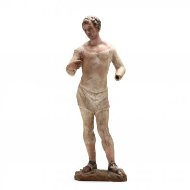 an-italian-carved-and-polychrome-figure-of-a-male-saint